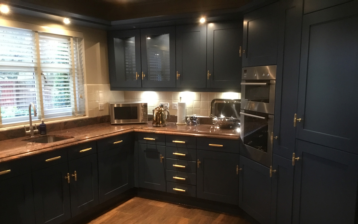 cherry laminated kitchen painted with little greene paint
